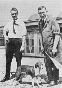 Charles Best (left) and Frederick Banting (right), Canadian physiologists and co- discoverers of the hormone insulin, standing with the first dog kept alive by insulin injections following the removal of its pancreas.